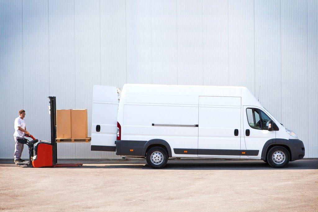 Worker loading packages in a sprinter van