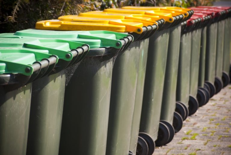 Differently colored trash bins for segregation
