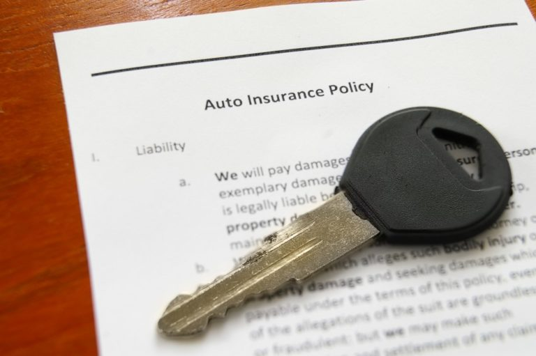 car key on auto insurance policy
