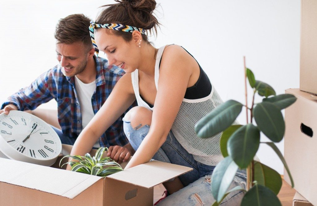 Couple packing for a big move