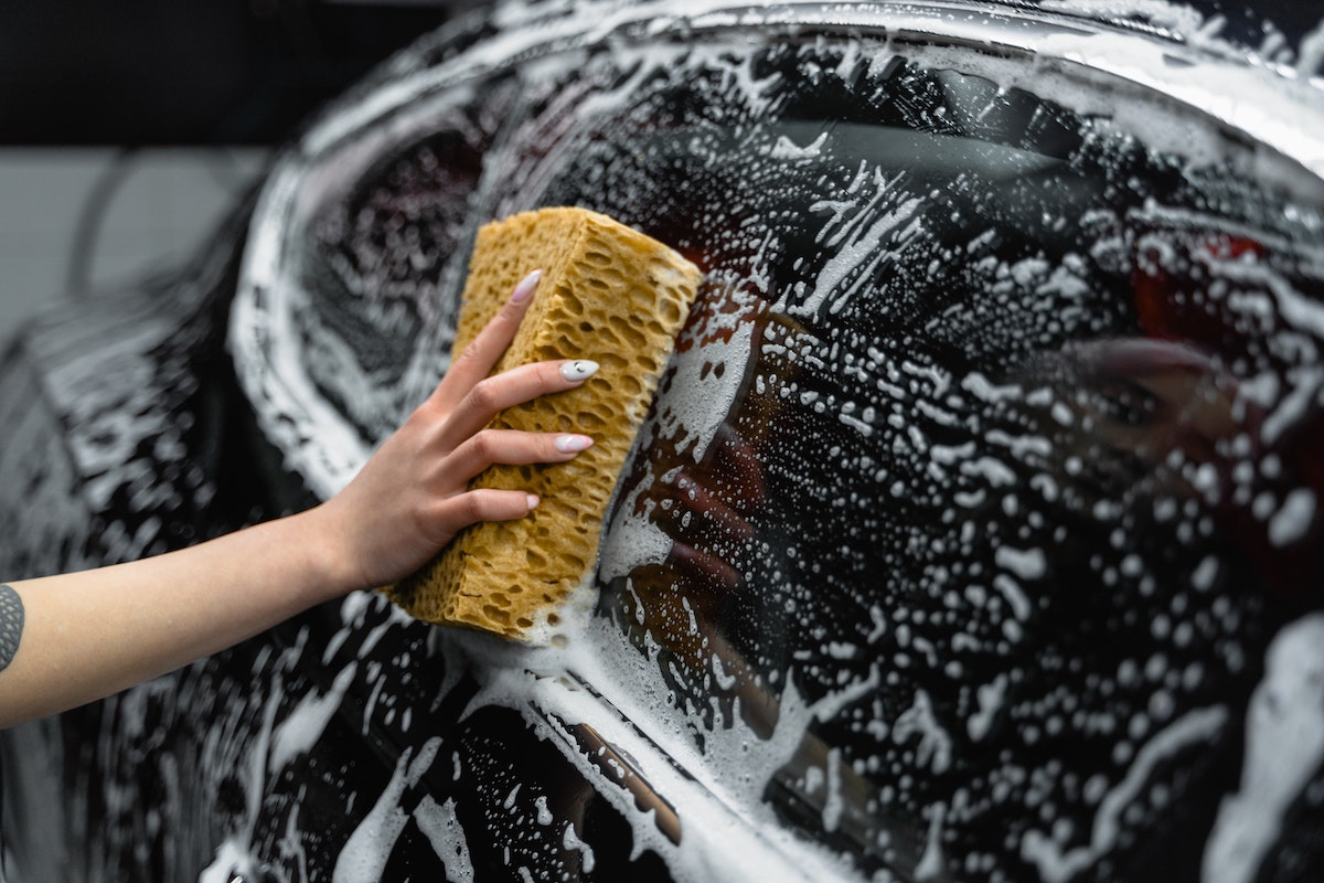 cleaning car with sponge