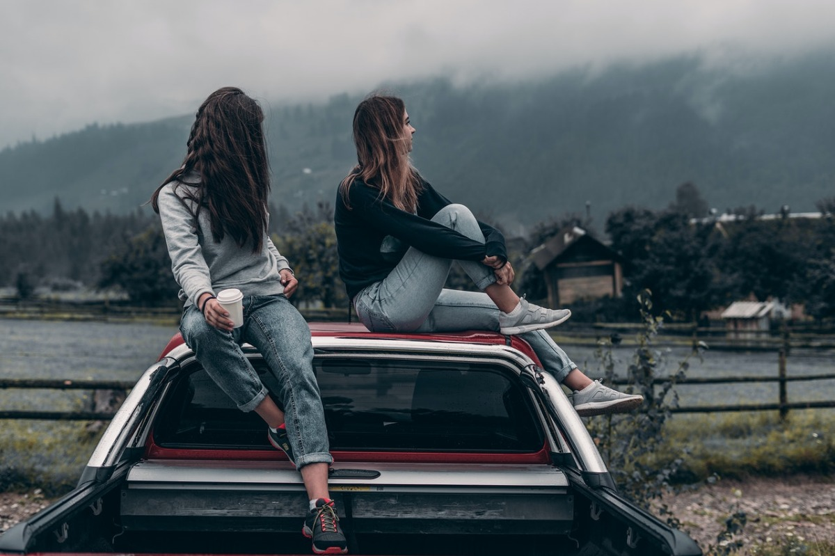 women sitting on a truck